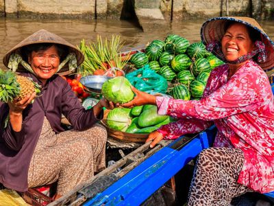 Vietnam Mekong Delta Marktfrauen schwimmender Markt Reise
